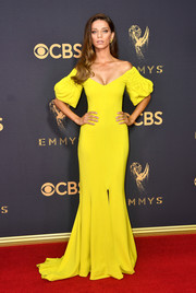 Angela Sarafyan looked divine at the 2017 Emmys wearing this Elizabeth Kennedy off-the-shoulder gown in an eye-popping shade of yellow!