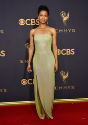 Gugu Mbatha-Raw cut a svelte silhouette in an iridescent green strapless gown by Boss at the 2017 Emmys.