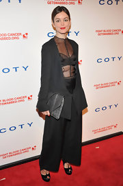 Nora Zehetner carried this gray alligator clutch with her unique black ensemble at the DKMS Gala.