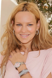 Natasha paired her diamond hoop earrings with a sterling silver watch.