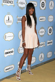 Naomi Campbell continued her streak of flawlessness in this white fit-and-flare dress with a drop waist.