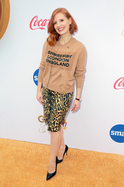 Jessica Chastain donned a beige Burberry logo cardigan and sweater combo for the Gold Meets Golden party.