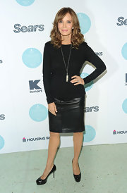 Jaclyn looked fashion forward in a black crewneck sweater over her leather skirt.