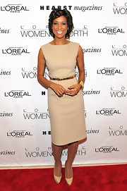 Sade Baderinwa wore a beige sheath dress with a gold belt and cuff to the Women of Worth Awards. She styled her look with coordinating platform pumps. This was a simple yet elegant outfit for the news anchor.