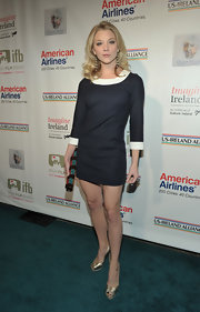 Natalie Dormer added shine to her black and white mini dress with gold platform peep toes.