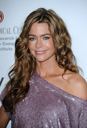 Denise Richards showed off her long curls while hitting the PETA party. Her luscious long locks are the perfect way to complete her red carpet look.
