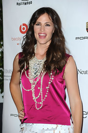 Jennifer Garner showed off her layered pearl necklaces while hitting the Pink Party in Hollywood.