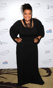Yvette Nicole Brown kept her look chic and simple with a flowing black gown that featured a cinched waist and peasant-style sleeves.