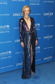 Nicole Kidman donned a plunging V-neck liquid blue dress with a midi slit and floral printed bodice to match the cool blue theme of the UNICEF ball.