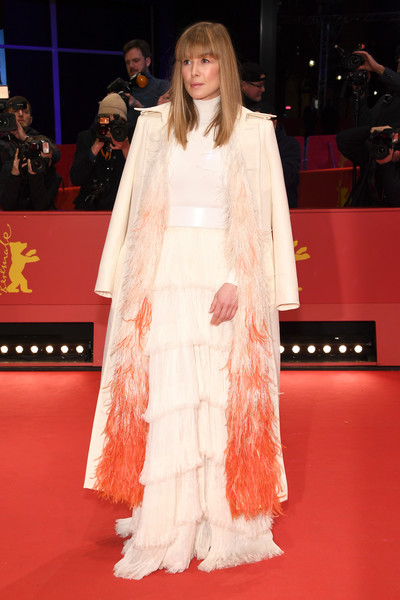 Rosamund Pike looked striking in a cream Givenchy Couture coat with ombre orange feather detailing at the Berlinale premiere of '7 Days in Entebbe.'