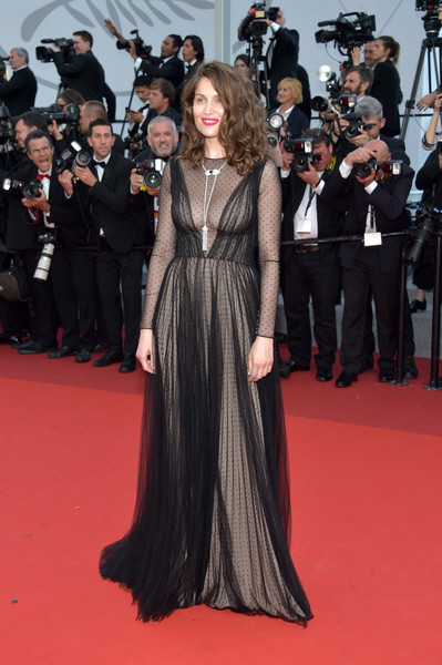 Laetitia Casta looked subtly sexy in a black Christian Dior Couture Swiss-dot gown with a nude underlay at the Cannes Film Festival 70th anniversary event.