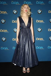 Saoirse Ronan looked fetching in this navy fit-and-flare gown by Calvin Klein at the 2018 Directors Guild of America Awards.