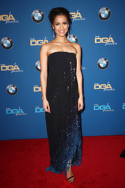 Gugu Mbatha-Raw chose an Oscar de la Renta ombre strapless gown with a fringed hem for the 2018 Directors Guild of America Awards.