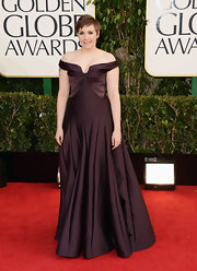Lena Dunham went for an ultra-feminine look at the Golden Globes in this burgundy off-the-shoulder gown.