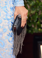 Nicole Richie paired her delicate Golden Globes gown with a tough-girl leather clutch trimmed in chains.
