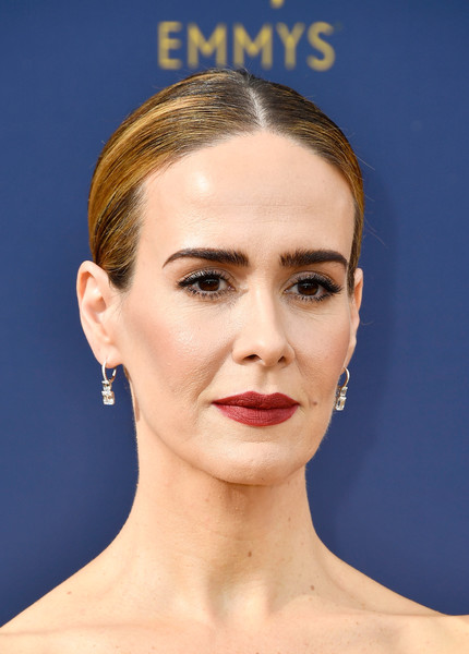 Sarah Paulson styled her hair into a tight center-parted bun for the 2018 Emmys.