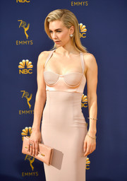Vanessa Kirby attended the 2018 Emmys carrying a chic pink python clutch by Tom Ford.