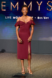 Samira Wiley looked sexy and feminine in a wine-red cold-shoulder dress by Cushnie et Ochs at the 70th Emmy Awards nominations announcement.