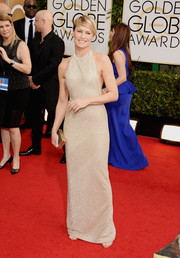 Robin Wright Penn looked fabulously svelte in a silver Reem Acra halter gown at the Golden Globes.