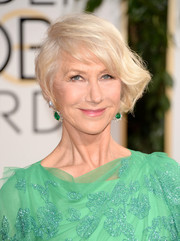 Helen Mirren wore her hair in a loose side-swept updo during the Golden Globes.