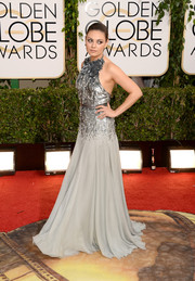 Mila Kunis looked downright fabulous in an embellished gray halter gown by Gucci Premiere during the Golden Globes.