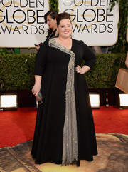 Melissa McCarthy went for subtle sparkle at the Golden Globes in a black gown embellished with silver sequins down the front.