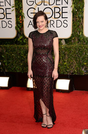 Elisabeth Moss looked seductive yet stylish in a beaded, sheer J. Mendel gown at the Golden Globes.