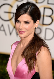 Sandra Bullock opted for a simple yet sweet ponytail with side-swept bangs when she attended the Golden Globes.
