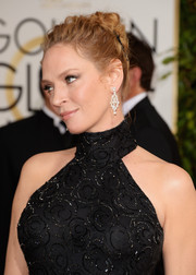Uma Thurman was edgy-glam with her twisted bun at the Golden Globes.