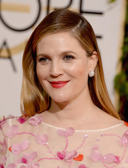Drew Barrymore opted for simple styling with this straight side-parted hairstyle when she attended the Golden Globes.