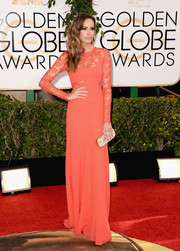 Louise Roe went the ultra-feminine route in a coral lace-panel gown by Monique Lhuillier during the Golden Globes.