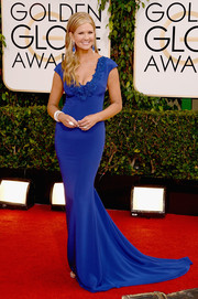 Nancy O'Dell showed off her svelte physique in a figure-hugging cobalt gown by Marchesa during the Golden Globes.