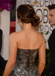 Kate Beckinsale attended the Golden Globes wearing a romantic side knot.