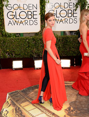 Emma Watson showed off her unique style in a red Dior dress with an open back, which she wore with pants, during the Golden Globes.