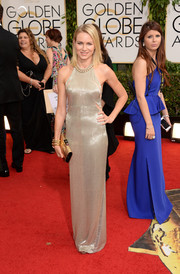 Naomi Watts looked flawlessly chic in a silver Tom Ford column dress with side cutouts during the Golden Globes.