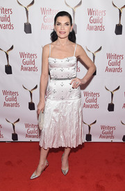 Julianna Margulies finished off her look with silver pumps by Sergio Rossi.