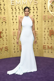 Padma Lakshmi kept it minimal yet chic in a white halter gown by Christian Siriano at the 2019 Emmys.
