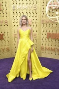 Kristin Cavallari matched her dress with a pair of yellow satin pumps.