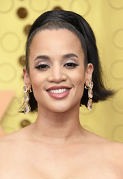 Dascha Polanco styled her hair into a high ponytail with flipped ends for the 2019 Emmys.