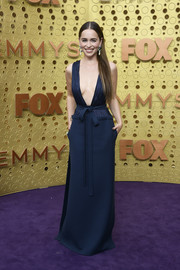 Emilia Clarke stole the spotlight in a navy Valentino Couture gown with a down-to-the-navel neckline at the 2019 Emmy Awards.