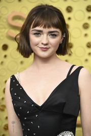 Maisie Williams has a daisy tattoo on her right arm.