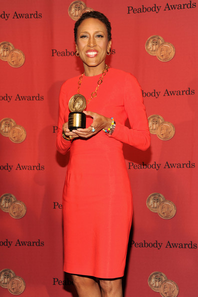 Robin Roberts chose a simple yet stylish long-sleeve orange sheath dress for the George Foster Peabody Awards.