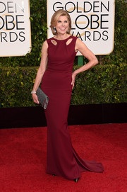 Christine Baranski donned a simple yet trendy burgundy Zac Posen column dress with yoke cutouts and an elegant train for the Golden Globes.