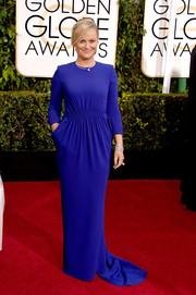 Amy Poehler kept it minimal yet regal in an electric-blue Stella McCartney evening dress at the Golden Globes.