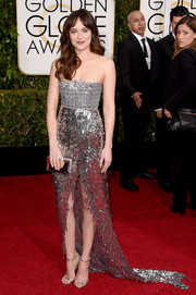 Dakota Johnson was all about skin and sparkles in a fully sequined, high-slit strapless gown by Chanel Couture at the Golden Globes.
