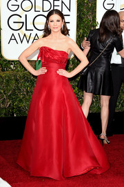 Catherine Zeta Jones went for some Scarlett O'Hara-inspired charm at the Golden Globes in a red Angel Sanchez strapless gown with a voluminous skirt and a structured bodice.