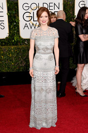 Ellie Kemper went for some Art Deco-inspired glamour in this elaborately beaded Naeem Khan gown during the Golden Globes.