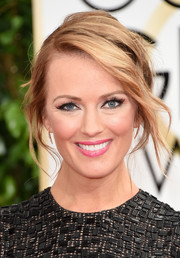 Brooke Anderson attended the Golden Globes looking gorgeous with her messy-glam updo.