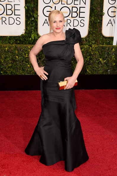 Patricia Arquette went for ladylike drama at the Golden Globes in a custom black Escada one-shoulder gown with huge rosette detailing.