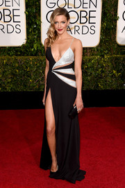 Katie Cassidy looked quite the bombshell at the Golden Globes in a black and silver Mikael D gown with multiple cutouts, a down-to-there neckline, a dangerously high slit.